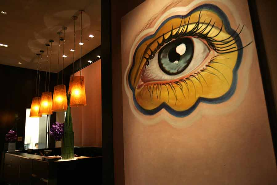 A large painted eye on the wall welcomes visitors to a restaurant in the Joule hotel in Dallas, Texas.