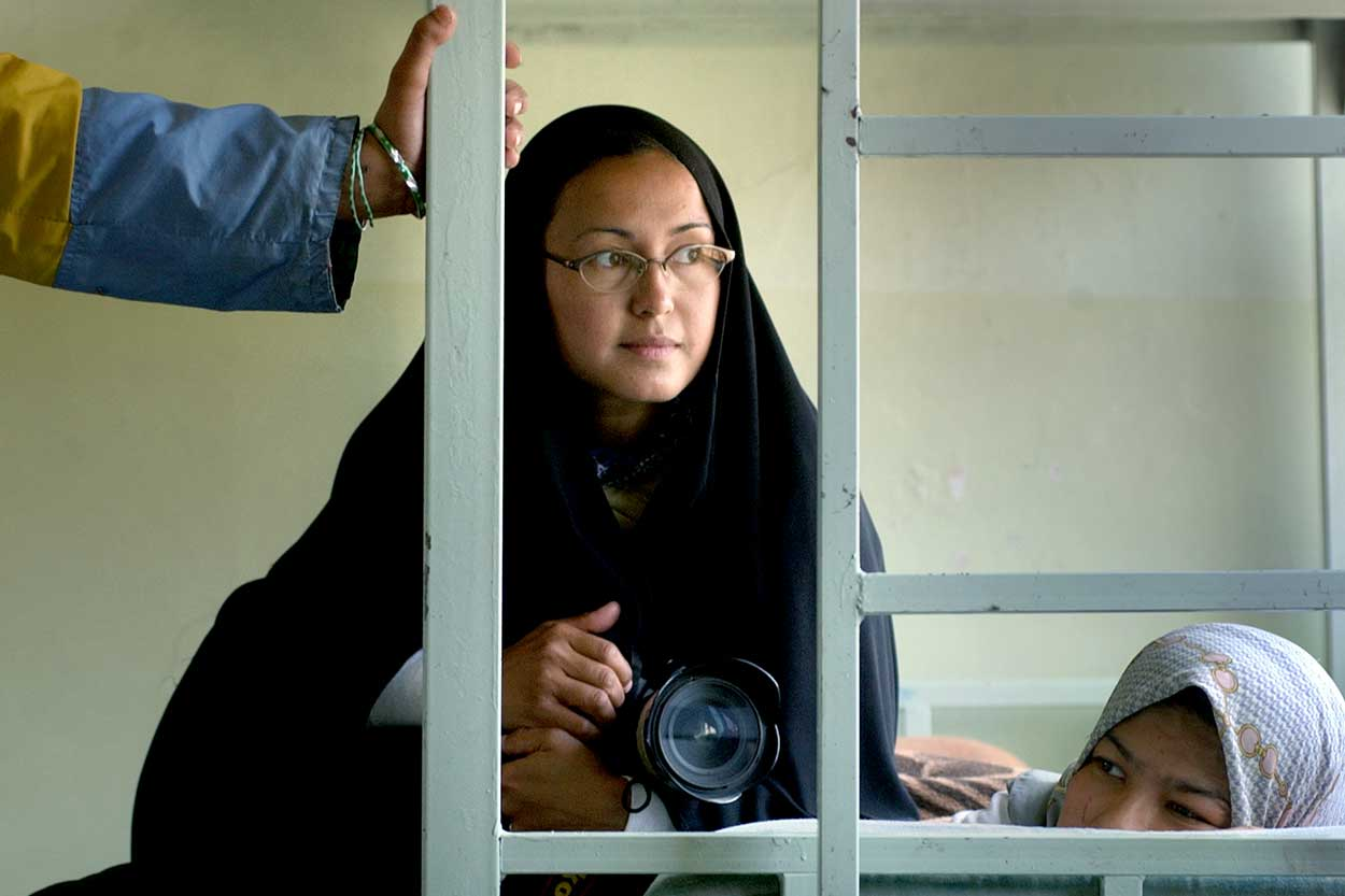 Photographer Cheryl Diaz Meyer wears a burka while working at an Iraqi orphanage after the invasion.