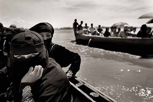 Myanmar's Rohingya refugee Anwara Nurhassan takes a boat from Chalpuridip, Bangladesh, as she journeys to refugee camps in search of safe haven.